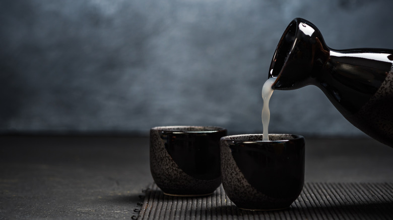 Sake pouring into sipping cups