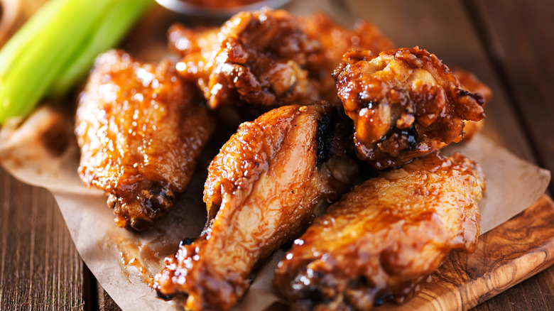 Cooked chicken wings on a plate with celery