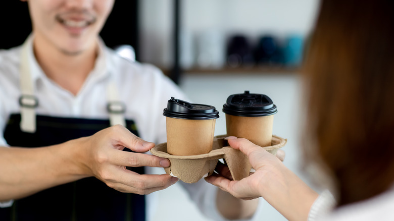 Paper coffee cups in tray