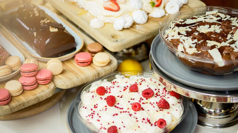 Desserts on brown wooden trays