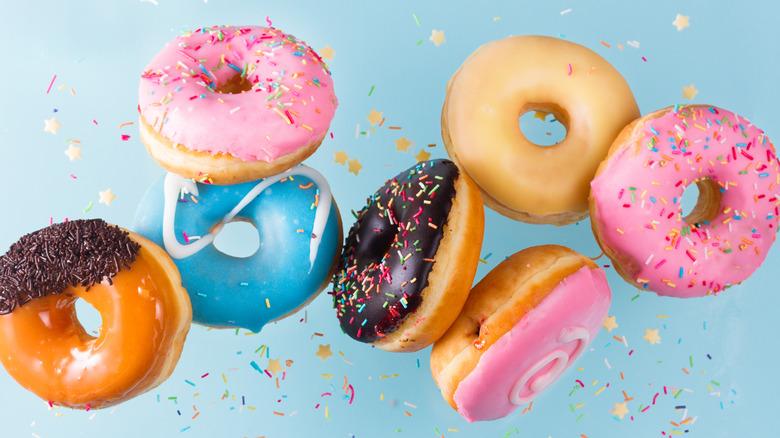 Pretty-colored doughnuts in the air like confetti