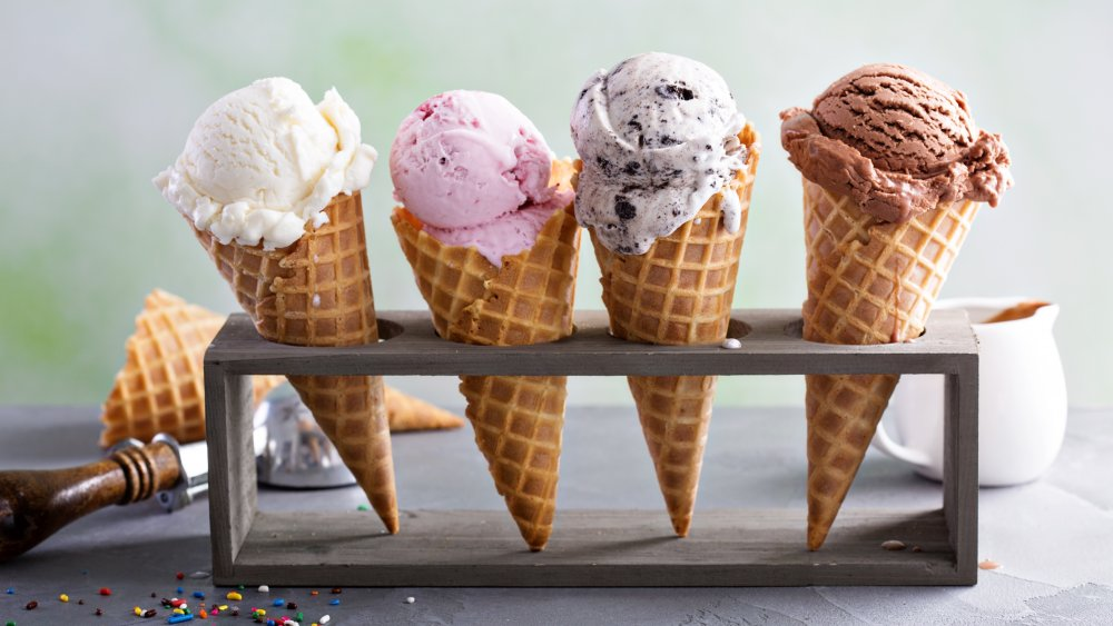 four ice cream scoops of different flavors in a holder