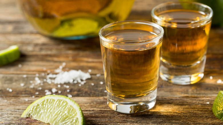 two tequila shots with lime and salt