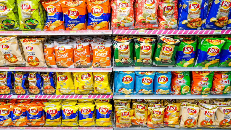 Shelf stocked with assorted chips