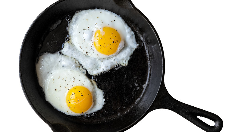 Cast iron pan of fried eggs
