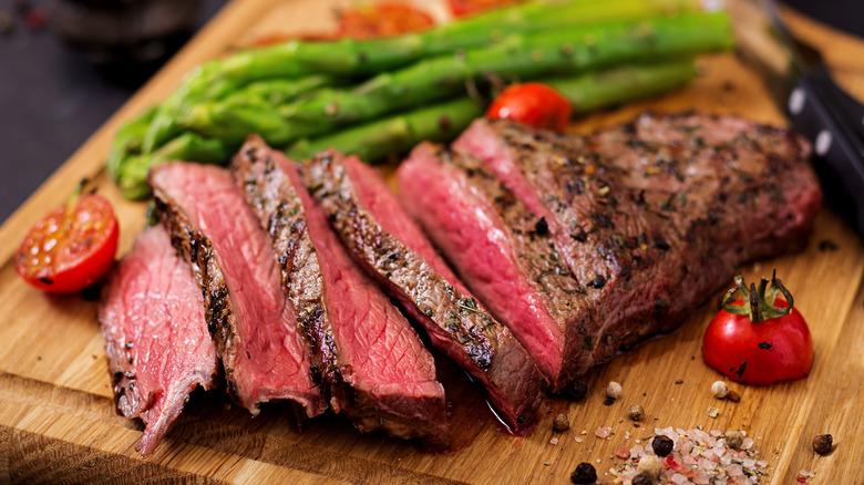 sliced steak, rare