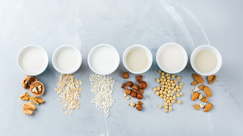 Different kinds of milk next to nuts