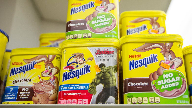 Shelf of stacked Nesquik containers