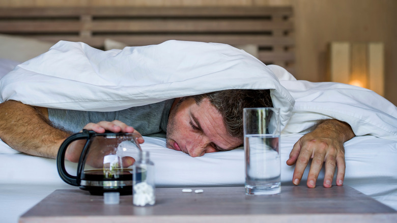 A generic image of a guy fighting a hangover