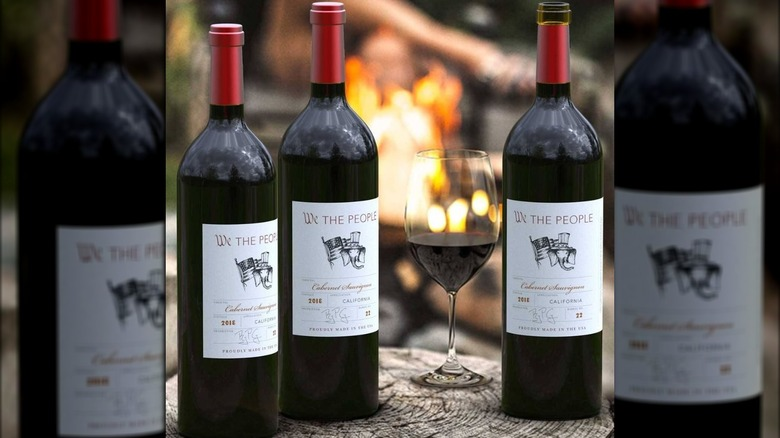 We The People wine bottles and wine glass