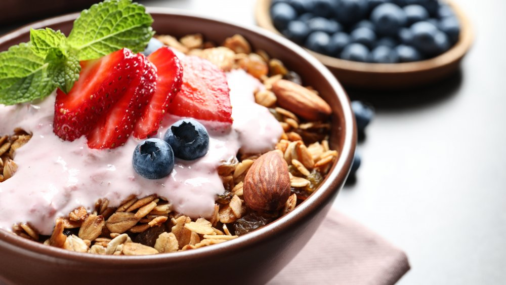 breakfast cereal in a bowl with fruit and yogurt