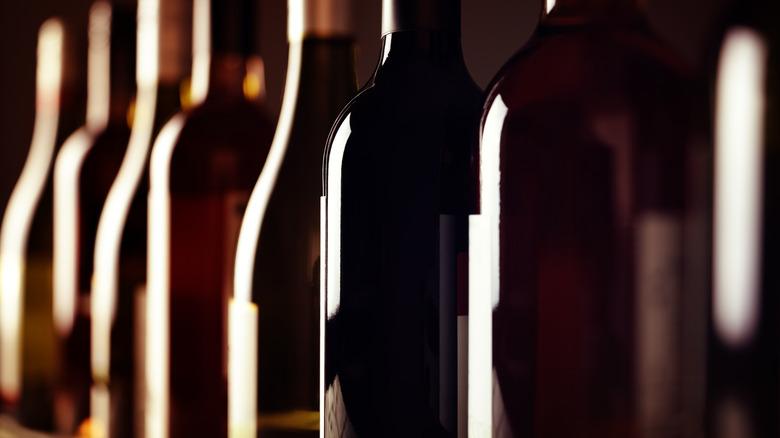 Shadowy row of wine bottles