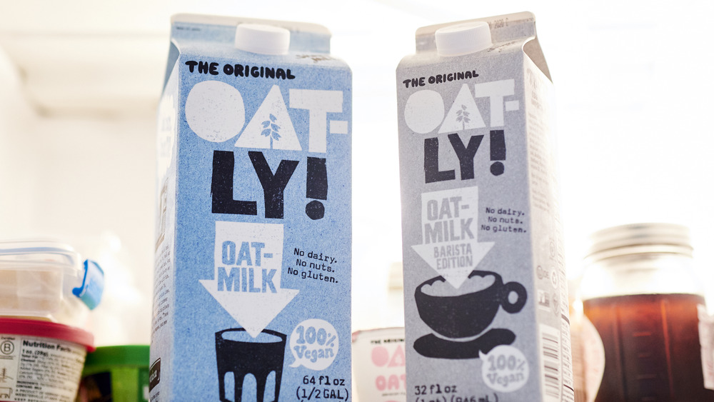 Carton of Oatly's on a fridge self