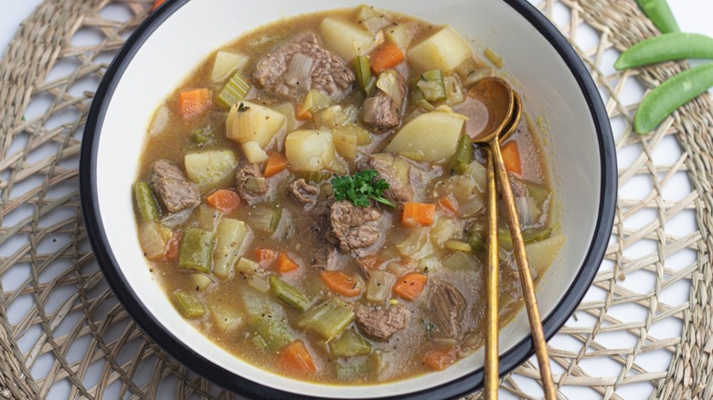 A serving of old fashioned vegetable beef soup in a bowl
