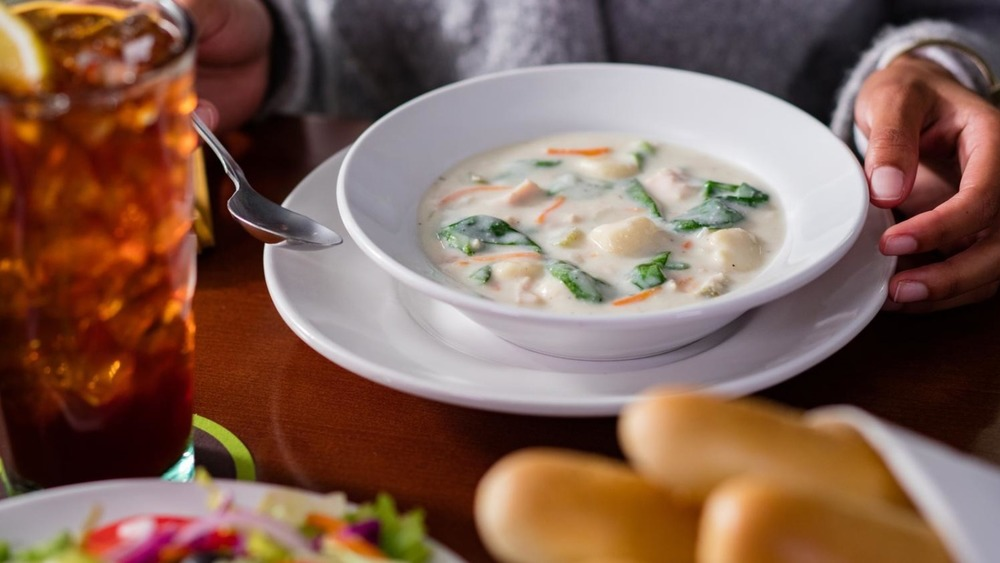 Olive Garden soup in white bowl