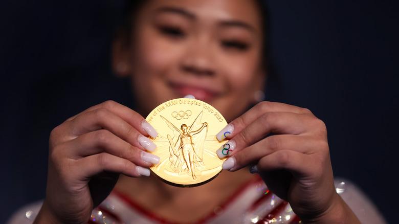 Sunisa Lee holding her gold medal
