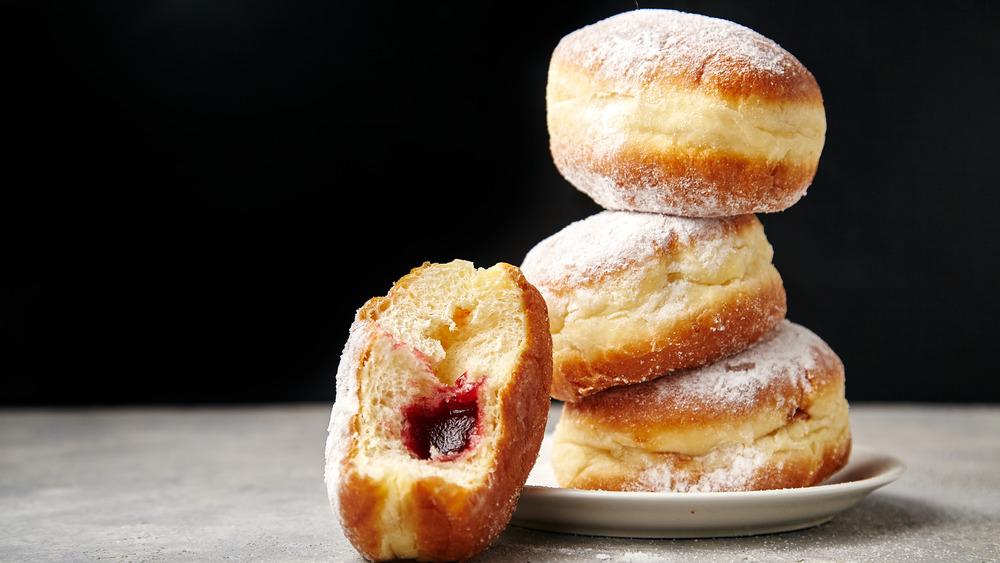 Jelly donuts precariously stacked
