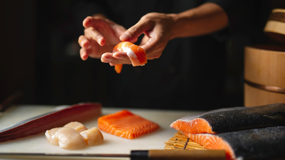 A close-up photo of a chef preparing sushi