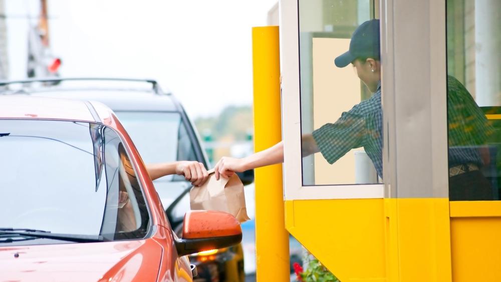 Drive-thru worker handing over food