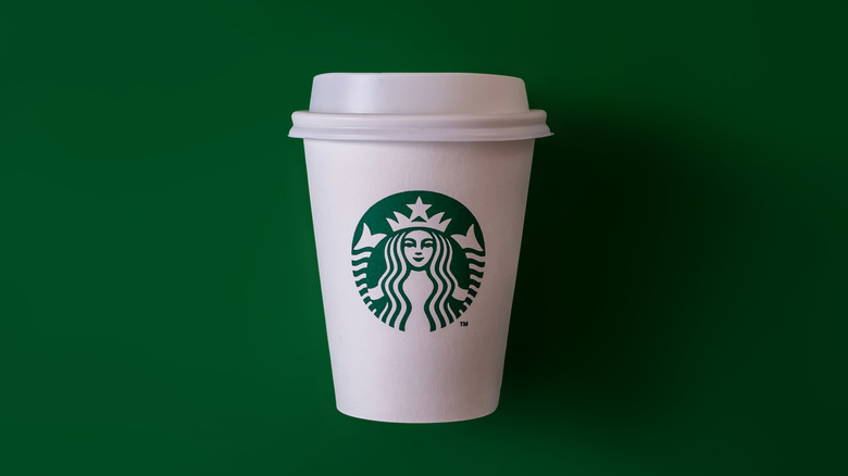 Starbucks hot drink cup on green background