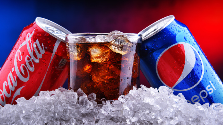 Can of coke and a can of Pepsi