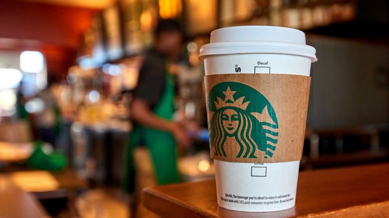 Starbucks cup on counter in store