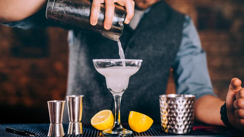 bartender pouring margarita