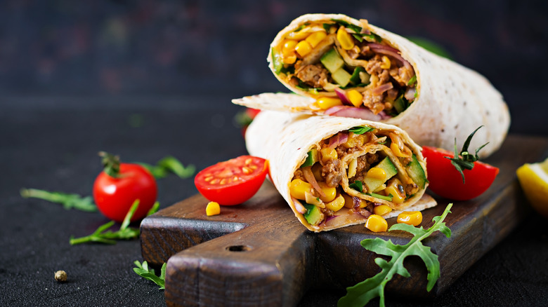 Two burritos stacked on top of each other