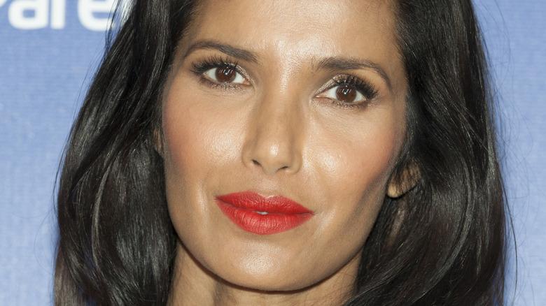 Closeup of Padma Lakshmi wearing red lipstick