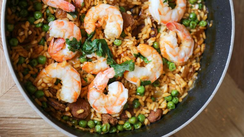paella with shrimp in metal pot