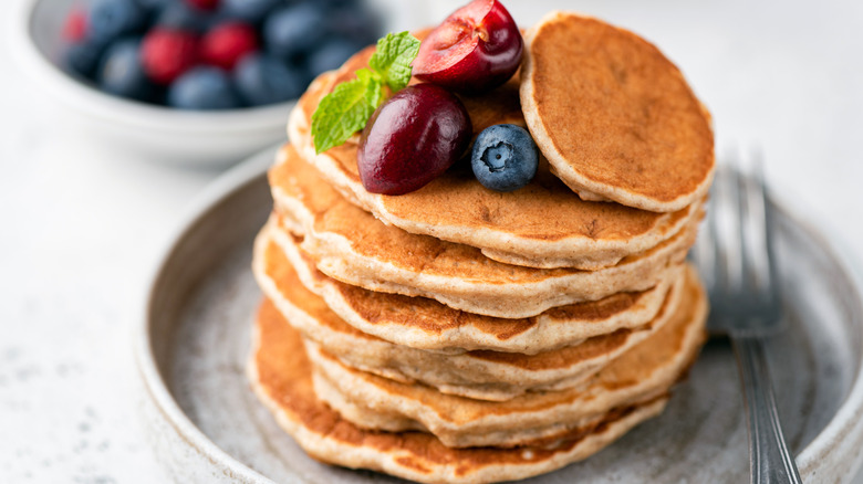 stack of pancakes and fruit