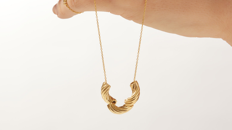 The gold-plated Panera Mac and Cheese necklace