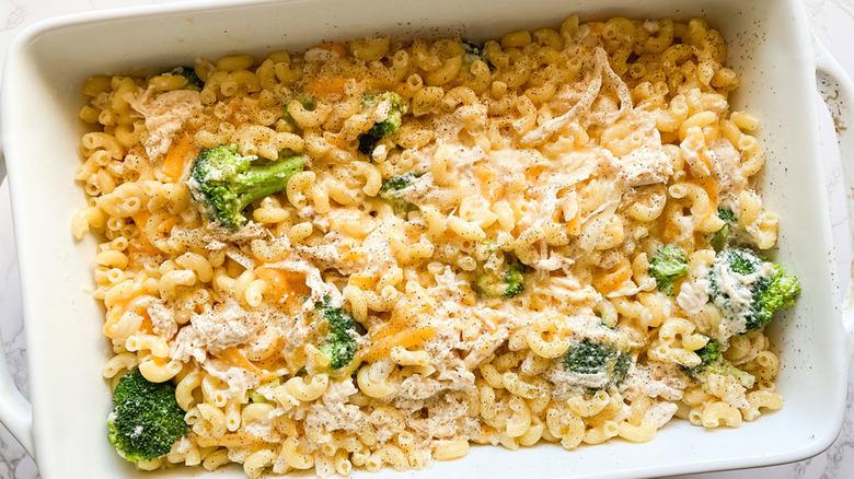 white baking dish full of chicken broccoli mac and cheese