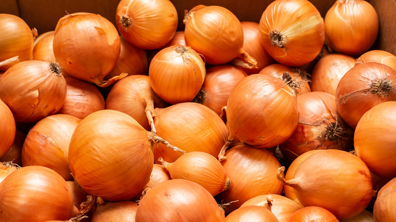 A stack of yellow onions