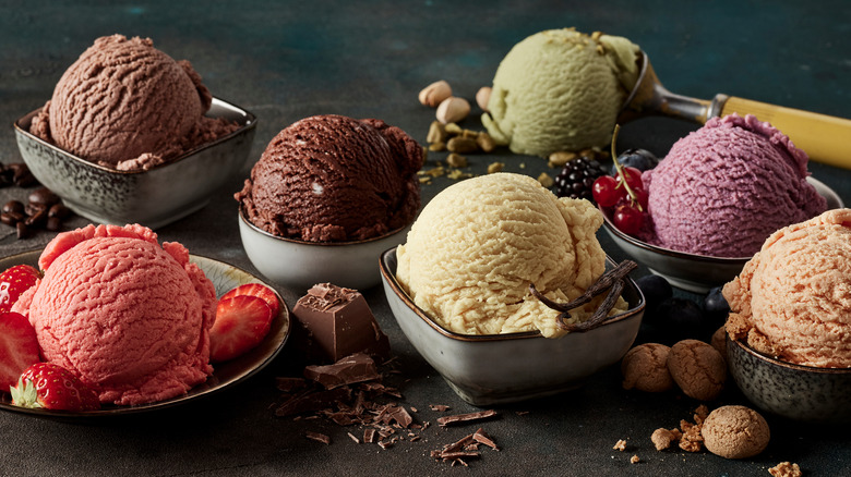 Scoops of ice cream in bowls with garnishes