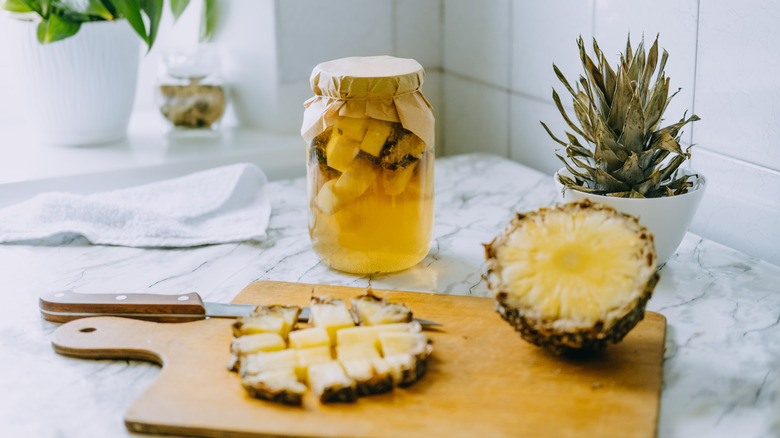 Pineapple cut up on a counter.
