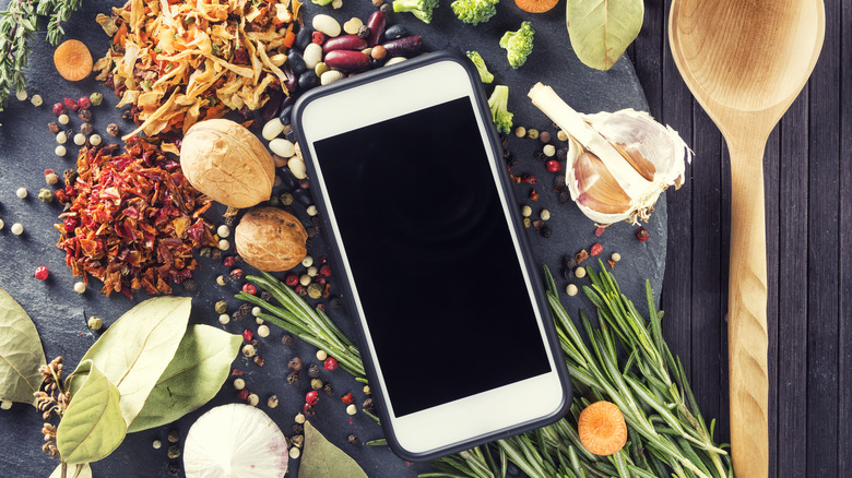 Smartphone and ingredients on table