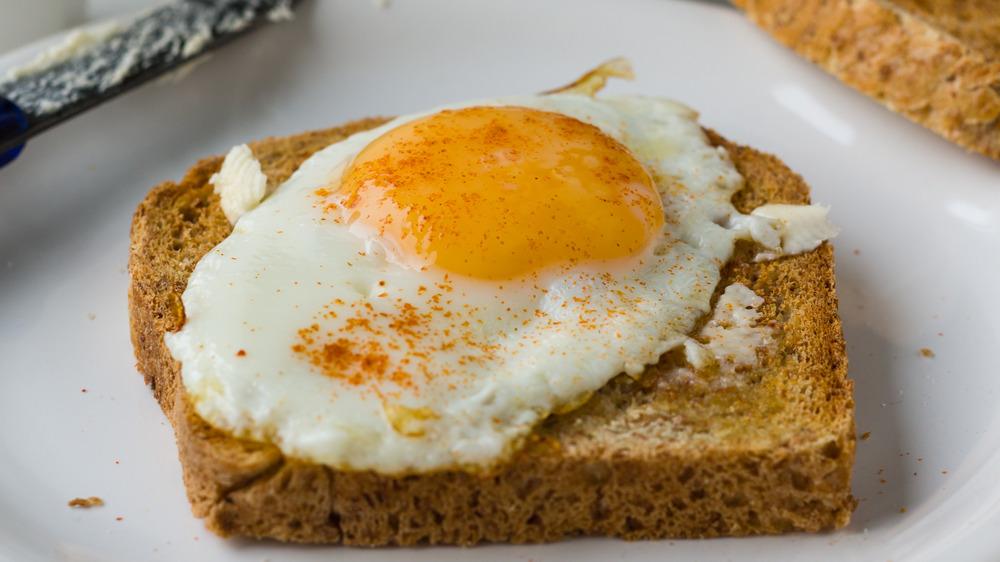 Sunnyside-up egg on toast