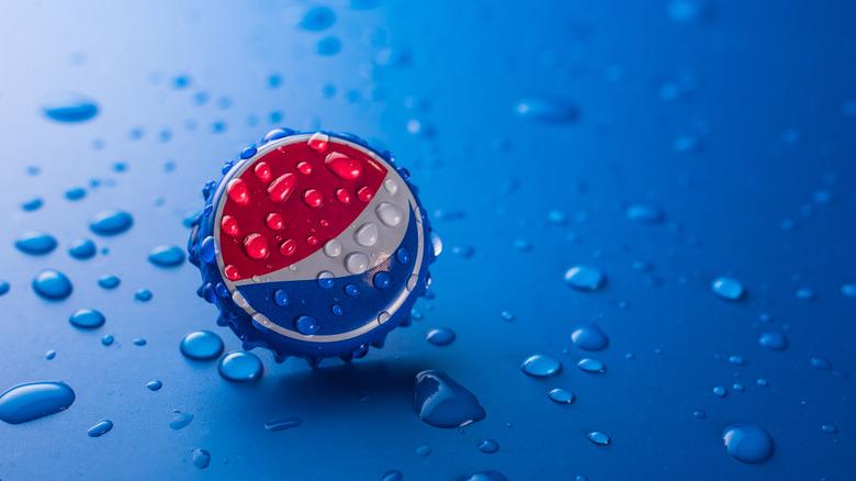 Pepsi bottle cap on blue background
