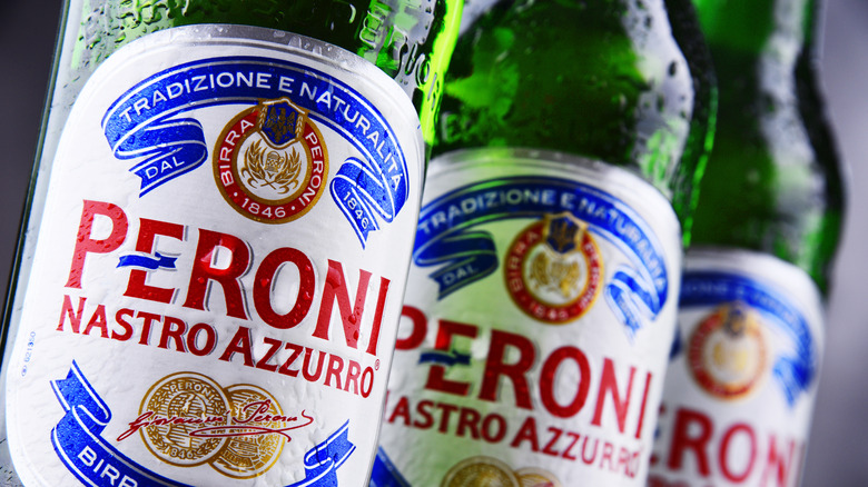 Bottles of Peroni beer with condensation