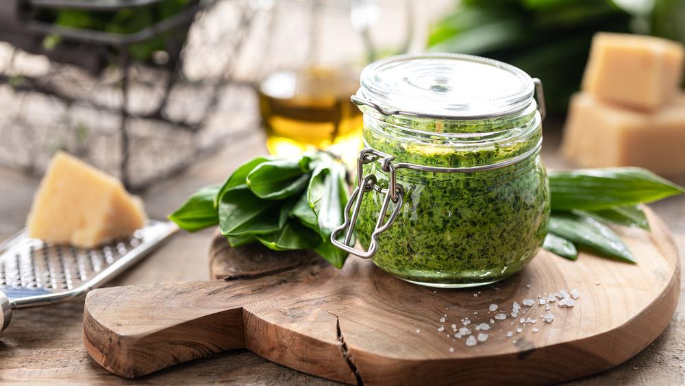 Pesto in a mason jar on a board