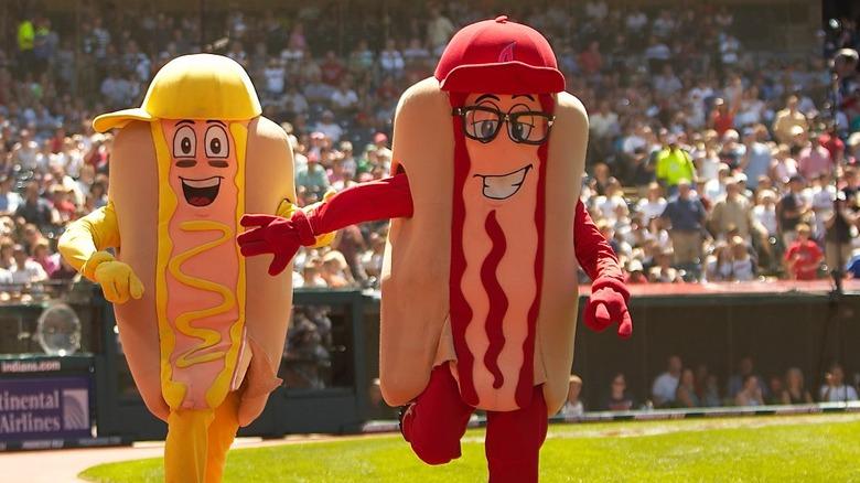 Hotdog costumed people at a baseball game