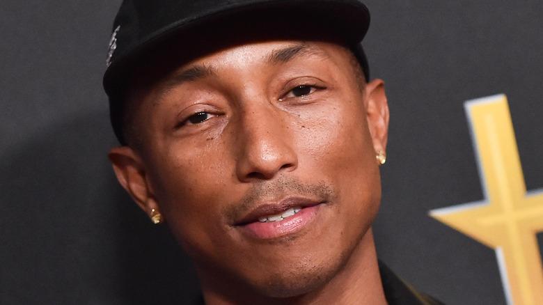 pharrell williams attending music event