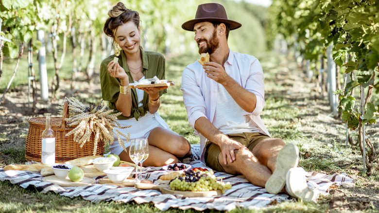 Woman and man enjoying a picnic