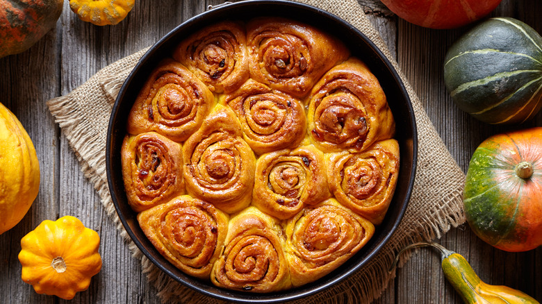 Cinnamon rolls in pan with autumnal accents