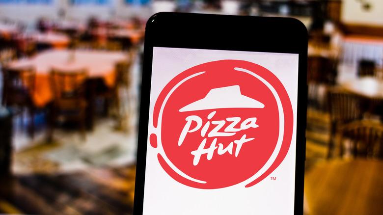 Pizza Hut logo on smartphone screen