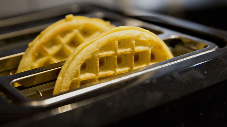 Frozen golden waffles in toaster