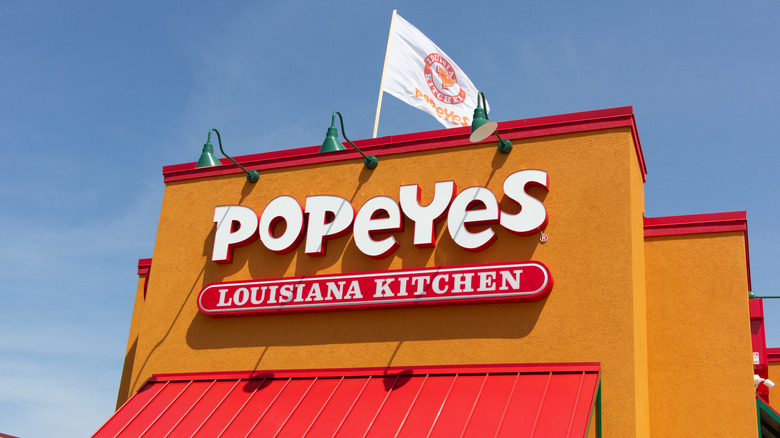 Popeyes storefront sign and flag