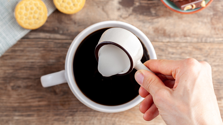 pouring creamer in cup