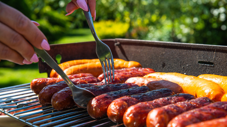 Cooking sausages on the grill